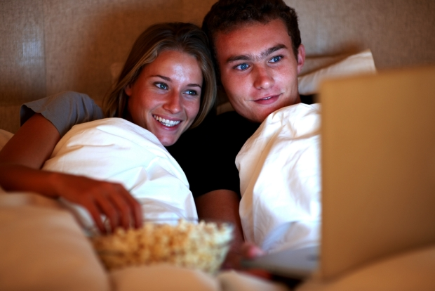 couple-watching-movie-in-bed
